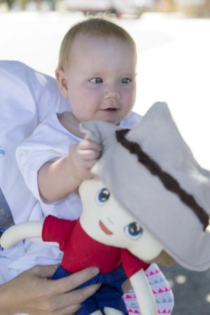 "Eight-month-old Grace Finley holding her ""Bill'' doll made for her in memory of her uncle Bill Spencer."