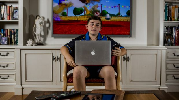 Hamish Insley, 12, has a variety of devices he uses to access the internet.