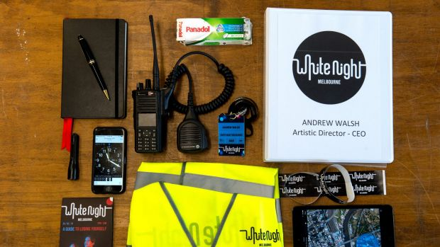 White Night artistic director Andrew Walsh's survival kit includes a diary, pen, radio, Panadol, folder, wrist bands, ...