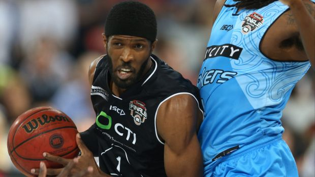 Melbourne United's Hakim Warrick tries to drive past New Zealand's Charles Jackson.