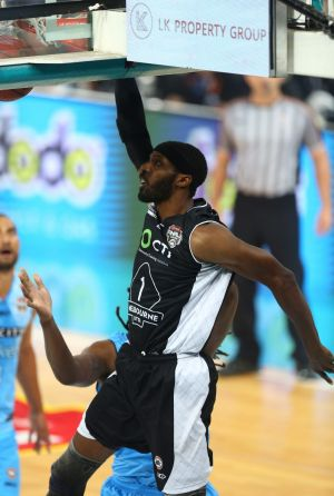 Melbourne United's Hakim Warrick dunks against New Zealand.