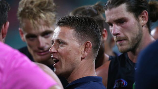 Blues coach Brendon Bolton speaks to his players during a break.