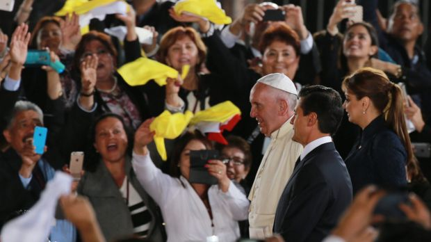 Cheering well-wishers greet Pope Francis in Mexico on Wednesday.