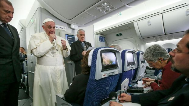 Pope Francis and journalists aboard the plane during the flight from Mexico to Italy on Wednesday.