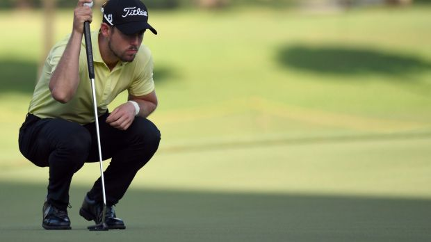 Looking good: Nathan Holman of Australia lines up for a putt on the 11th hole.
