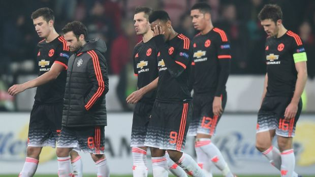 In shock: Manchester United players show their dejection after their defeat.