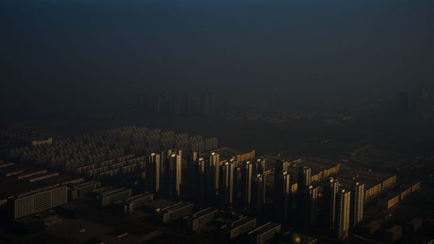 """""""Haze in China"""" by photographer Zhang Lei won first prize in the 'Contemporary Issues Singles' category. It shows a city ..."""