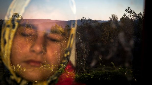 """""""Into the Light"""" by Zohreh Saberi shows Iranian Raheleh, who was born blind, standing behind the window in the morning. ..."""