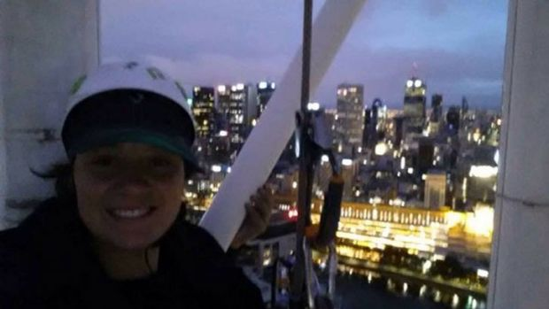 Protester Katherine Woskett on the Arts Centre spire.