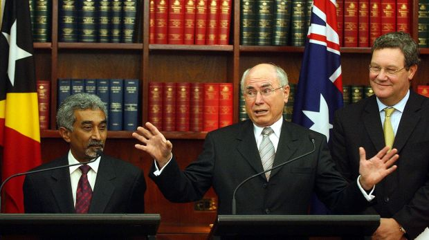 """East Timor's then prime Minister Mari Alkatiri with John Howard and Alexander Downer in 2006 after signing a """"Treaty on ..."""