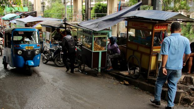 Jakarta street vendors - known as kaki lima - are a vital part of the Indonesian economy.