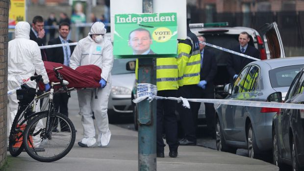 The body of Eddie Hutch is removed from a property in Poplar Row in Dublin after he was shot in his home in apparent ...