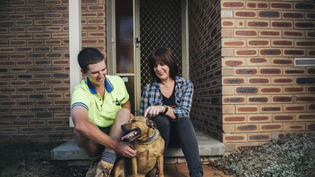 Josh Lancaster with Pumpkin and her owner Jenny Spear. His return of Pumpkin to her Wanniassa home was something special.