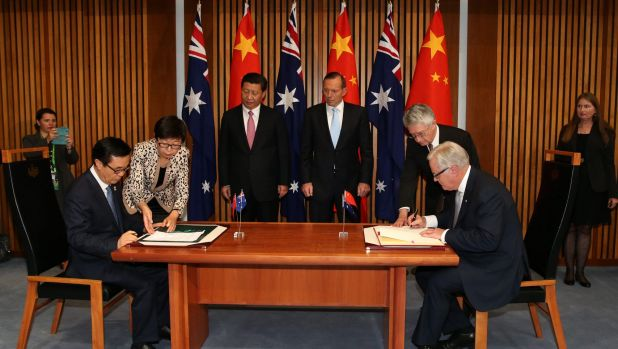 Chinese President Xi Jinping and then prime minister Tony Abbott witness the signing of the declaration of intent on the ...