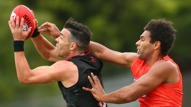 Ryan Crowley takes a mark over James Gwilt.