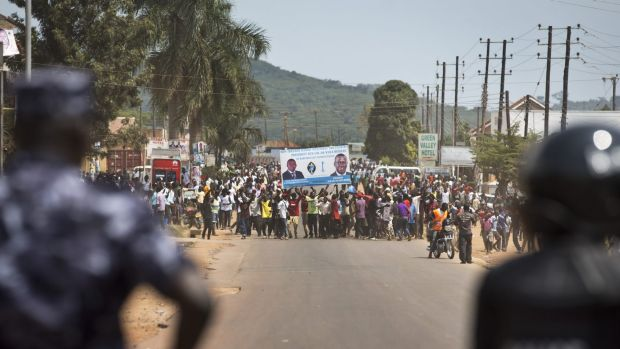 Ugandan riot police confront angry voters in Ggaba, outside a polling station where voting materials for presidential ...