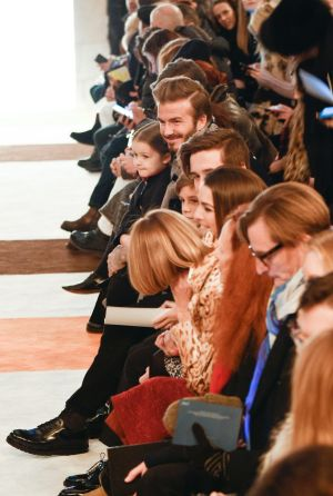 Harper sits front row at her mother's NYFW show alongside Vogue editor-in-chief Anna Wintour.