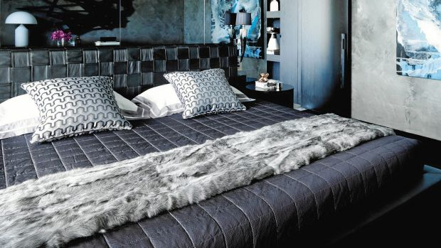 Natale chooses a more dramatic blue-grey palette  for this Elizabeth Bay apartment.