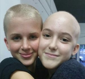 Annaleise (right) with her friend Jaime, who shaved her head to support her friend.