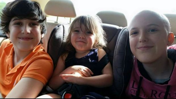 Annaleise Curtis with her younger brother Lincoln and sister Sophia.