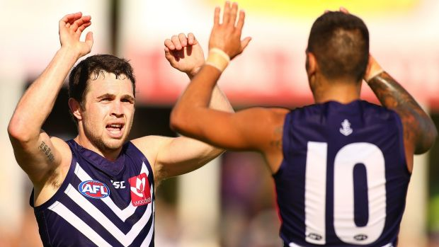 Hayden Ballantyne and Michael Walters of the Dockers celebrate a goal.