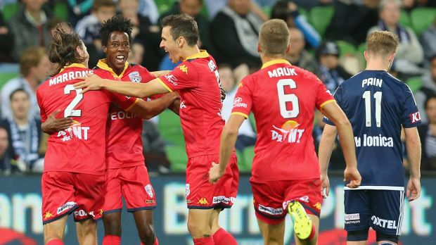 Bruce Kamau of United is congratulated by teammates after scoring.