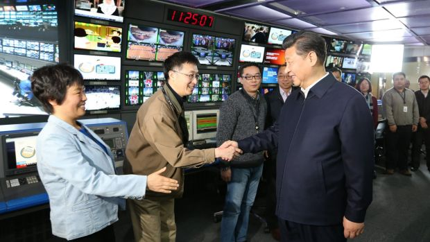 Propaganda offensive ... In this photo released by China's Xinhua News Agency, Chinese President Xi Jinping, right, ...