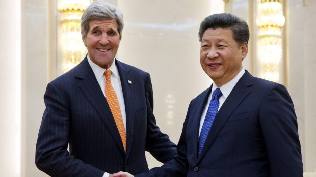 US Secretary of State John Kerry, left, poses with Chinese President Xi Jinping prior to their meeting at the Great Hall ...