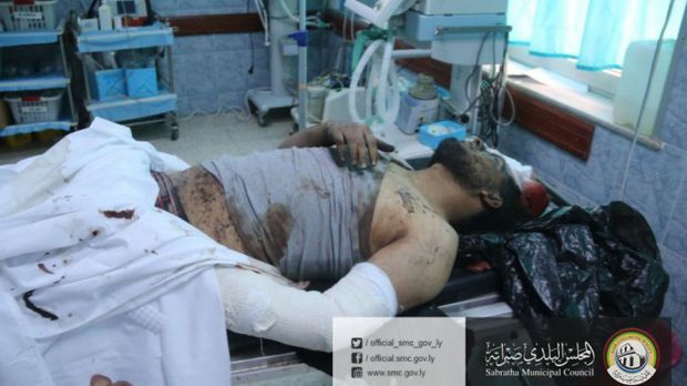 A wounded man lies in a hospital after US warplanes struck an Islamic State training camp in Sabratha.
