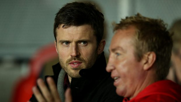 Star power: Manchester United's Michael Carrick gets some pointers from Roosters coach Trent Robinson during the World ...