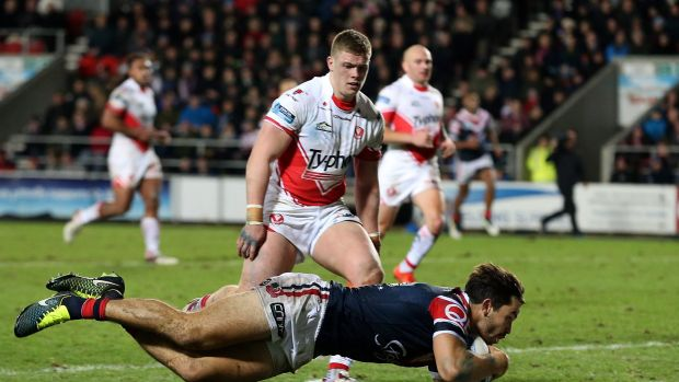 Try time: Aidan Guerra crosses for the Roosters against St Helens.