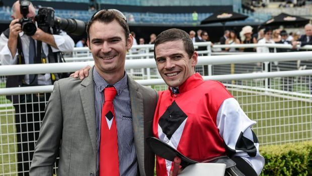 Golden day: Trainer Todd Willan with jockey Mitchell Bell following Artlee's win in the Country Championship last year.