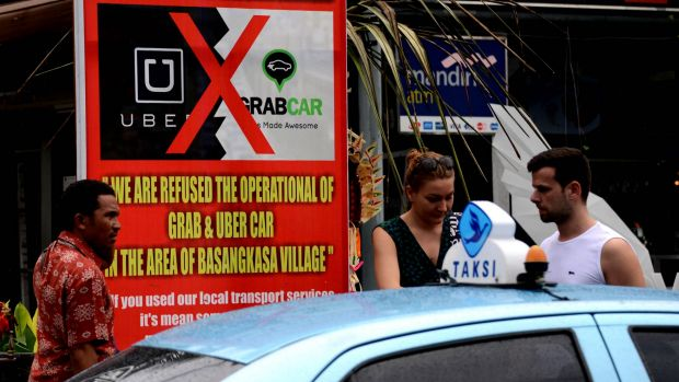 Renegade ride-sharing service Uber is not only defying a ban on its cars in Bali but has upped the ante by offering ...