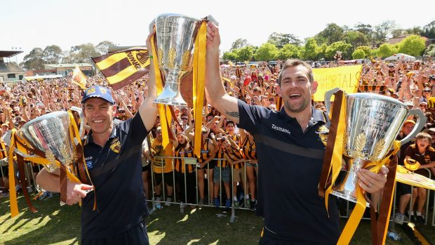 Three-peat: Clarkson and Luke Hodge with the 2013, 2014 and 2015 premiership cups.