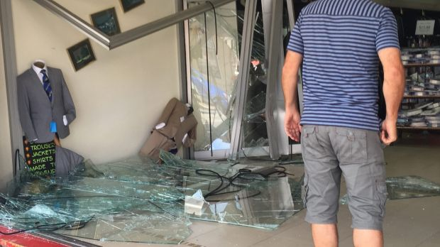 The destroyed front window of clothing store House of Albert in Parramatta.
