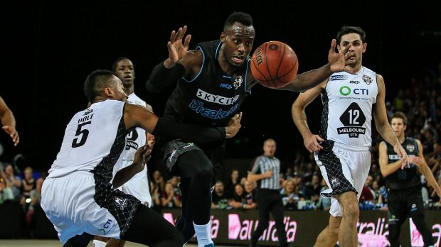 Ouch: Cedric Jackson of the Breakers is fouled during his side's win over Melbourne United.