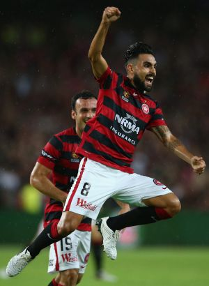 Dimas of the Wanderers celebrates Dario Vidosic's goal.