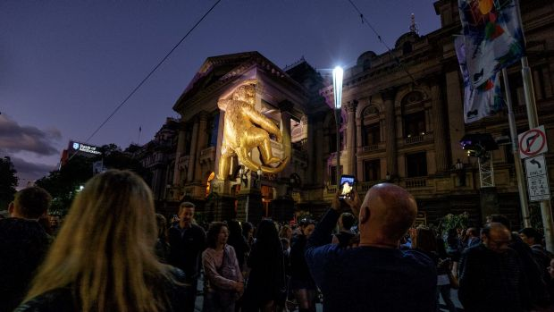 A giant golden monkey clambers up Melbourne Town Hall ... for White Night 2016.