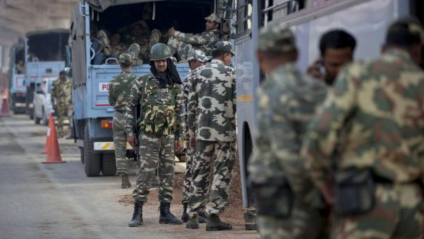Paramilitary soldiers guard from a distance as protestors of India's Jat agricultural community block a highway linking ...