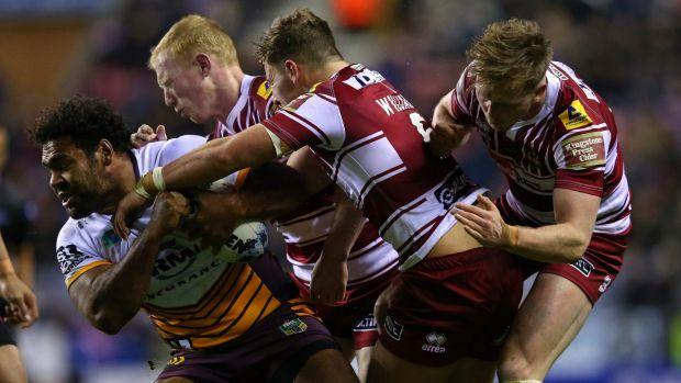 Manhandled: Sam Thaiday is crunched.