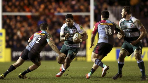 Gap runner: Leicester Tigers star Manu Tuilagi goes between Harlequins defenders Harry Sloan and Ben Botica.