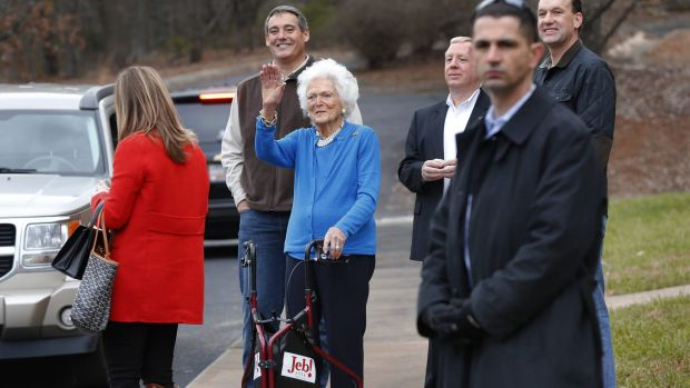 Barbara Bush waves goodbye to her son outside a polling place in Greenville, South Carolina. Her return to the campaign ...