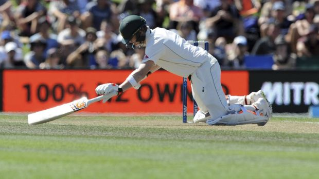 Nasty blow: Australia's Steve Smith falls forward after being hit on the helmet from a ball bowled by New Zealand's Neil ...