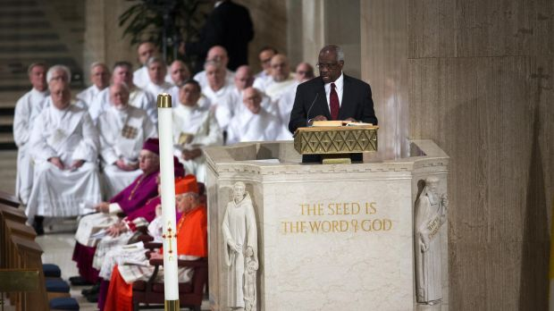 Supreme Court judge Clarence Thomas gives a reading during the funeral of Justice Antonin Scalia.