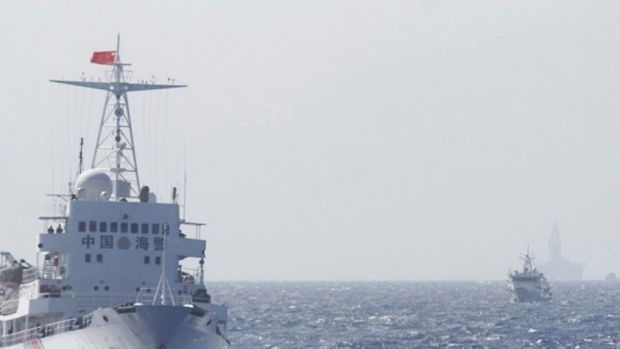 Chinese Coast Guard ships are seen near the Chinese oil rig Haiyang Shi You 981 in disputed waters in the South China Sea.