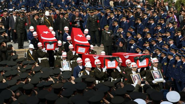 Soldiers carry the coffins of eight of the 28 victims of Wednesday's bomb attack in Ankara.