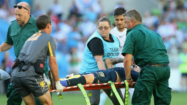 Horrific injuries: Mariners defender Storm Roux is stretchered from the field.