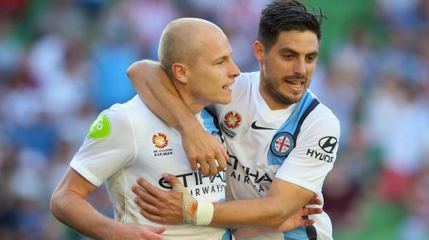 Strike force: Aaron Mooy celebrates with Bruno Fornaroli after scoring City's fourth.