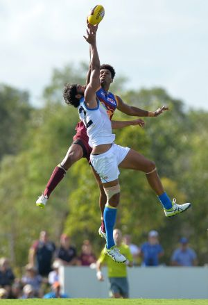 Hang time: Brisbane's Archie Smith and Suns' Tom Nicholls fly high.