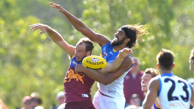 Tussle: Brisbane's Josh Walker goes up against Gold Coast's Tom Nicholls.
